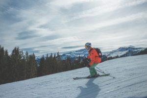 A person skiing down a mountain.